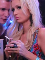 Paris Hilton seen at a club vaping